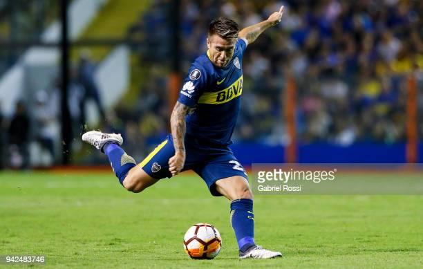 Julio Buffarini of Boca Juniors kicks the ball during a group phase match between Boca Juniors and Junior as part of the Copa CONMEBOL Libertadores...