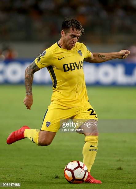 Julio Buffarini of Boca Juniors kicks the ball during a groups stage match between Alianza Lima and Boca Juniors as part of Copa Conmebol...