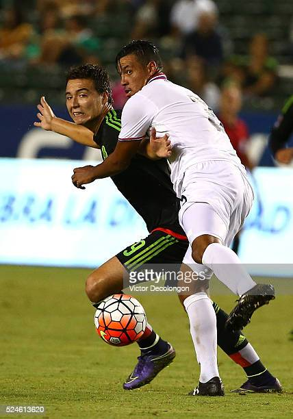 Julio Cascante of Costa Rica marks Erick Torres of Mexico during the 2015 CONCACAF Olympic Qualifying Group B match at StubHub Center on October 2...