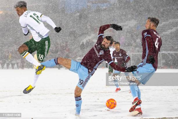 Julio Cascante of Portland Timbers and Jack Price of Colorado Rapids reach for the ball during the second half at Dick's Sporting Goods Park on March...