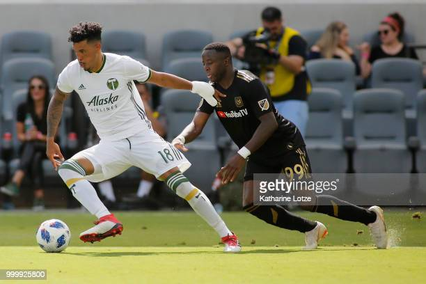 Julio Cascante of the Portland Timbers and Adama Diomande of the Los Angeles Football Club fight for control of the ball at Banc of California...