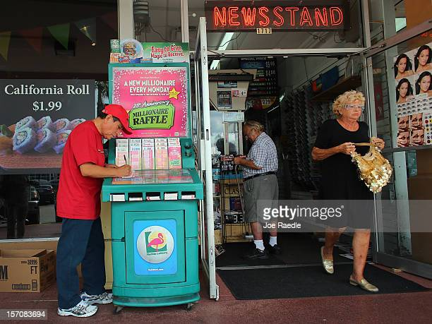Julio Caso fills out his Powerball numbers as he buys a ticket at Circle News Stand on November 28, 2012 in Hollywood, Florida. The jackpot for...