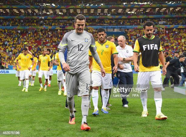 Julio Cesar and players of Brazil walk off the pitch after the 2014 FIFA World Cup Brazil 3rd Place Playoff match between Brazil and Netherlands at...
