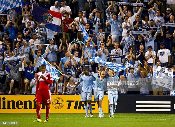Julio Cesar Aurelien Collin and Chance Myers of Sporting Kansas City celebrate a 21 win over FC Dallas at Livestrong Sporting Park on March 25 2012...