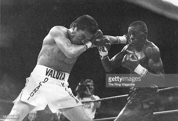 Julio Cesar Chavez connects with a left punch to Roger Mayweather during the fight at the Great Western Forum on May 131989 in Inglewood California...