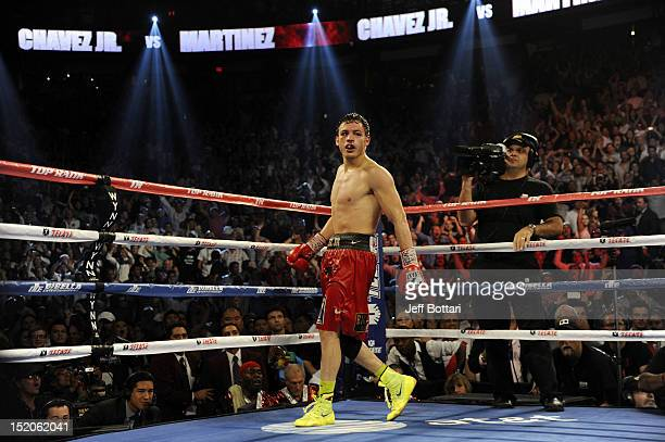 Julio Cesar Chavez Jr is instructed to walk away by referee Tony Weeks after knocking down Sergio Martinez in the twelfth round of their WBC...