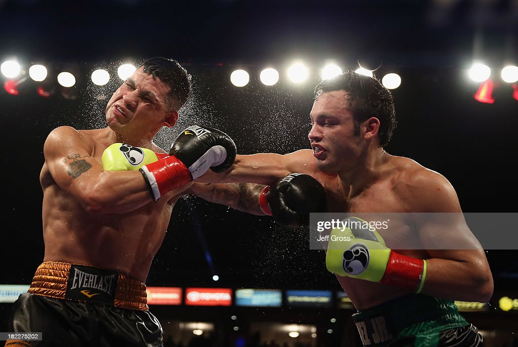 Julio Cesar Chavez Jr. (R) lands a right hand to the head of Brian Vera during their Light Heavyweight bout at StubHub Center on September 28, 2013 in Los Angeles, California.