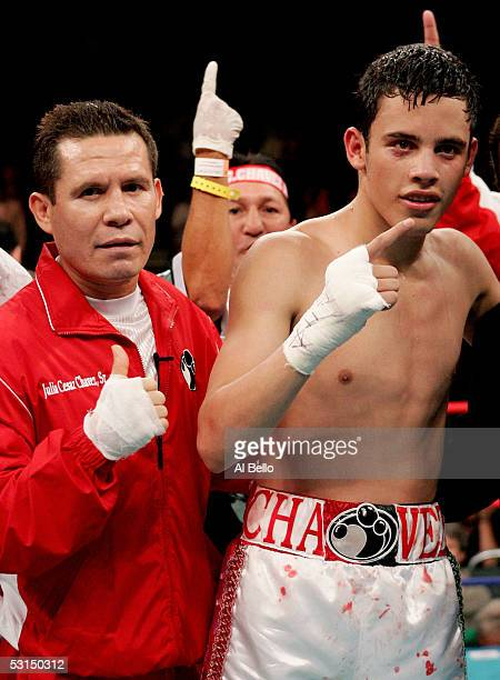 Julio Cesar Chavez Jr poses with his father former boxer Julio Cesar Chavez after Chavez Jr defeated Ruban Galvan in the Junior Welterweight fight at...