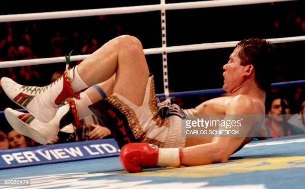 Julio Cesar Chavez of Mexico hits the canvas after being knocked down by challenger Frankie Randall of the US in the 11th round of their WBC super...