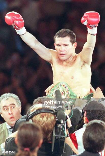 Julio Cesar Chavez of Mexico is carried around in victory after beating David Kamau of the US in their WBC Super Lightweight Championship fight at...