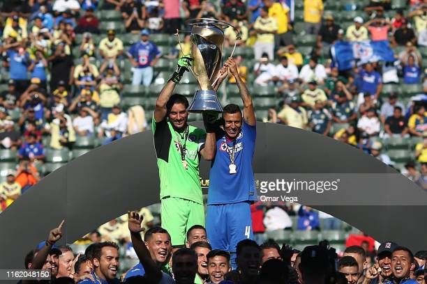 Julio Cesar Dominguez and Goalkeepper Jesus Corona of Cruz Azul lifts the Trophy to celebrates after winning the match between Cruz Azul and Necaxa...