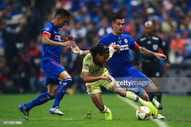 Julio Cesar Dominguez and Milton Caraglio of Cruz Azul struggle for the ball with Diego Lainez of America during the final second leg match between...
