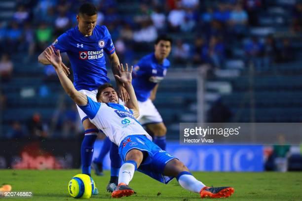 Julio Cesar Dominguez of Cruz Azul struggles for the ball with Alejandro Chumacero of Puebla during the 8th round match between Cruz Azul and Puebla...