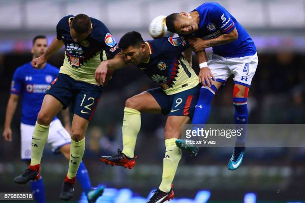 Julio Cesar Dominguez of Cruz Azul struggles for the ball with Pablo Aguilar and Silvio Romero of America during the quarter finals second leg match...