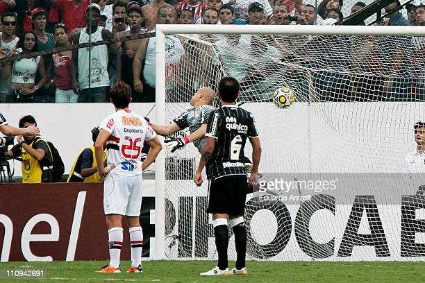 Julio Cesar, goalkeeper of Corinthias, fails to defend the kick of Rogerio Ceni, goalkeeper of Sao Paulo who did his 100th goal, during a match as...