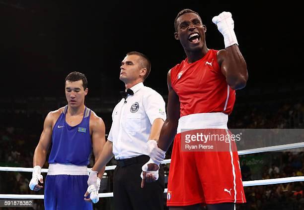 Julio Cesar La Cruz of Cuba celebrates after winning gold against Adilbek Niyazymbetov of Kazakhstan in the Men's Light Heavy event on Day 13 of the...