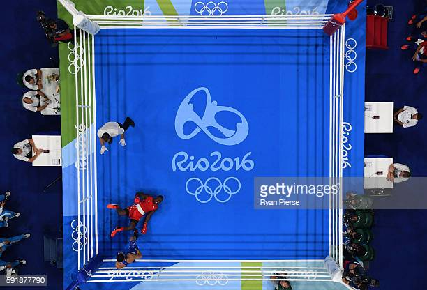 Julio Cesar La Cruz of Cuba fights against Adilbek Niyazymbetov of Kazakhstan during the Men's Light Heavy Gold Medal bout on Day 13 of the 2016 Rio...