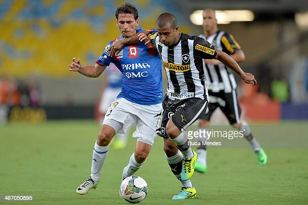 Julio Cesar of Botafogo struggles for the ball with a Andrade of Deportivo Quito during a match between Botafogo and Deportivo Quito as part of Copa...