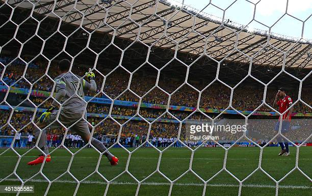 Julio Cesar of Brazil celebrates after saving a penalty kick from Mauricio Pinilla of Chile during the 2014 FIFA World Cup Brazil round of 16 match...