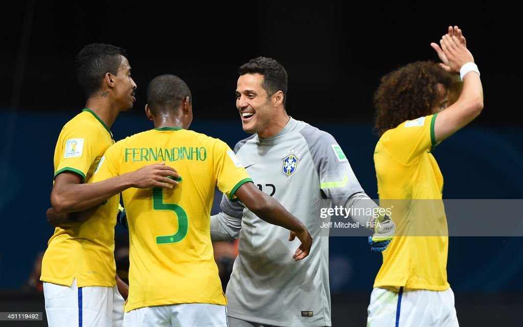 Julio Cesar of Brazil celebrates with team-mates after winning the 2014 FIFA World Cup Brazil Group A match between Cameroon and Brazil at Estadio Nacional on June 23, 2014 in Brasilia, Brazil.