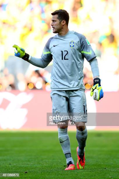 Julio Cesar of Brazil reacts after saving a penalty kick by Mauricio Pinilla of Chile in a penalty shootout during the 2014 FIFA World Cup Brazil...