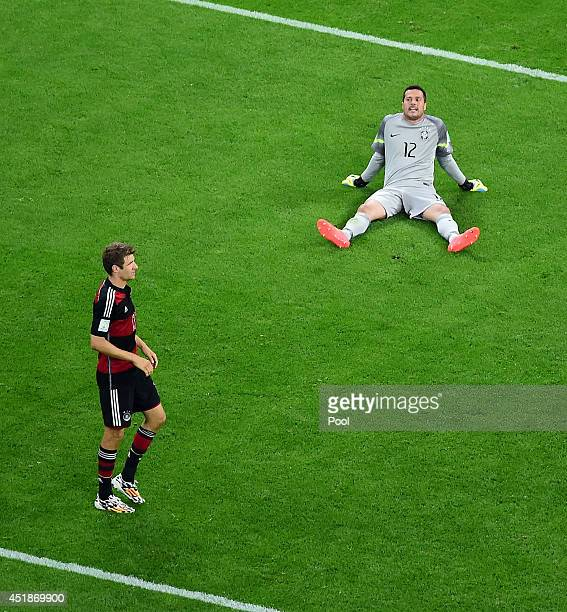 Julio Cesar of Brazil reacts as Thomas Mueller of Germany looks on during the 2014 FIFA World Cup Brazil Semi Final match between Brazil and Germany...