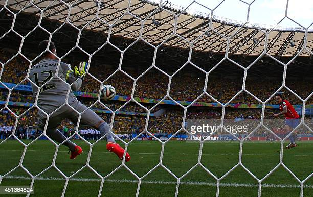 Julio Cesar of Brazil saves a penalty kick from Mauricio Pinilla of Chile during the 2014 FIFA World Cup Brazil round of 16 match between Brazil and...