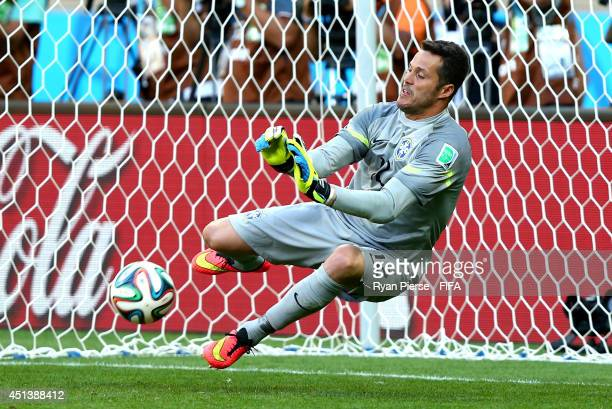 Julio Cesar of Brazil saves a penalty kick from Mauricio Pinilla of Chile in a penalty shootout during the 2014 FIFA World Cup Brazil Round of 16...