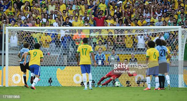 Julio Cesar of Brazil saves the penalty kick of Diego Forlan of Uruguay during the FIFA Confederations Cup Brazil 2013 Semi Final match between...