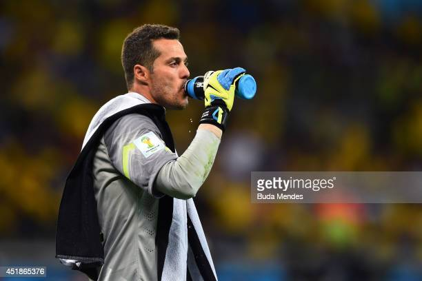 Julio Cesar of Brazil takes on fluids during the 2014 FIFA World Cup Brazil Semi Final match between Brazil and Germany at Estadio Mineirao on July 8...
