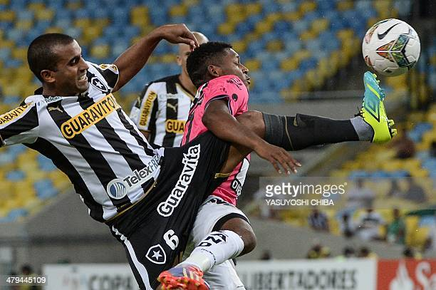 Julio Cesar of Brazil's Botafogo vies for the ball with Jonathan Gonzalez of Ecuador's Independiente del Valle during their 2014 Copa Libertadores...