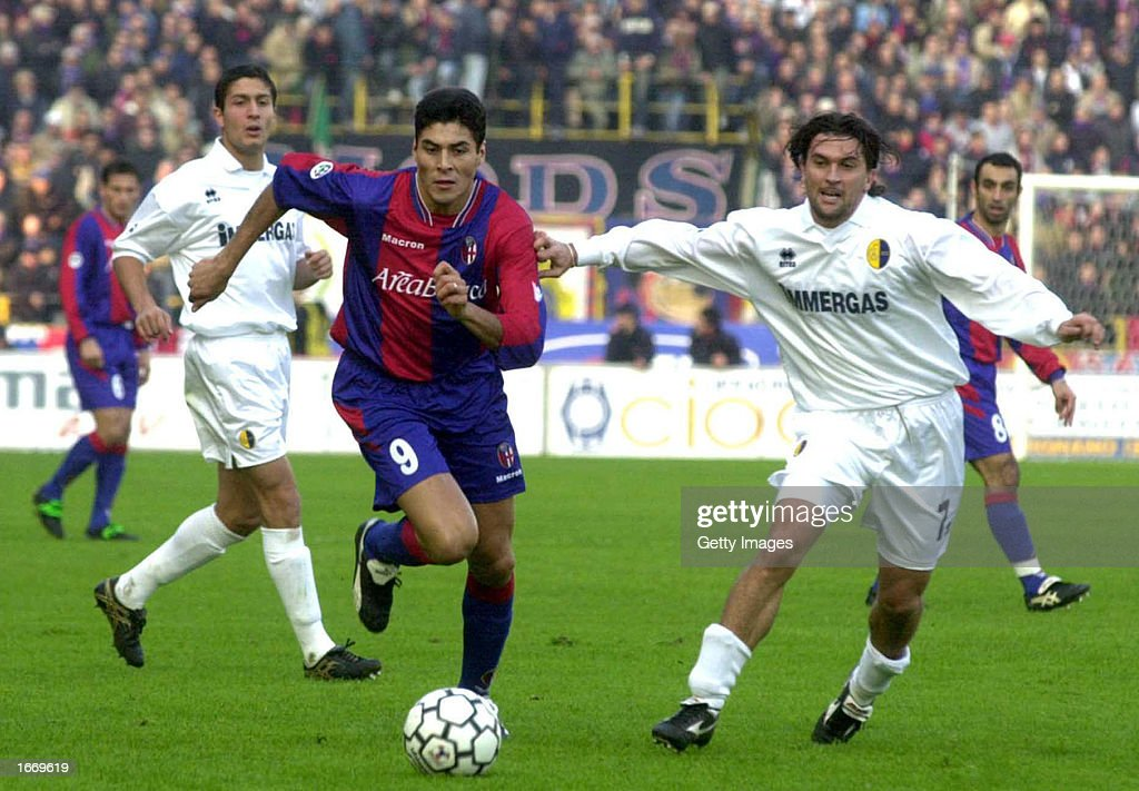 Julio Cruz of Bologna and Omar Milanetto of Modena in action... : News Photo