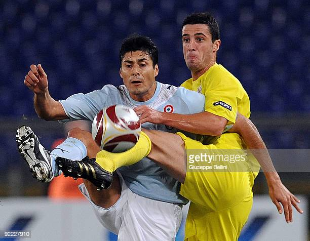 Julio Cruz of SS Lazio and Ivan Marcano of Villarreal CF in action during the UEFA Europa League group G match between SS Lazio and Villareal CF at...