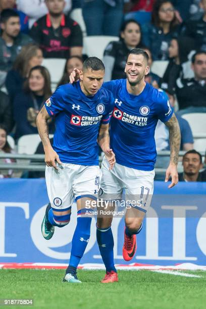 Julio Dominguez of Cruz Azul celebrates with teammate Edgar Mendez after scoring his team´s second goal during the 7th round match between Monterrey...