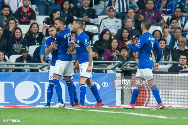 Julio Dominguez of Cruz Azul celebrates with teammates after scoring his team´s second goal during the 7th round match between Monterrey and Cruz...