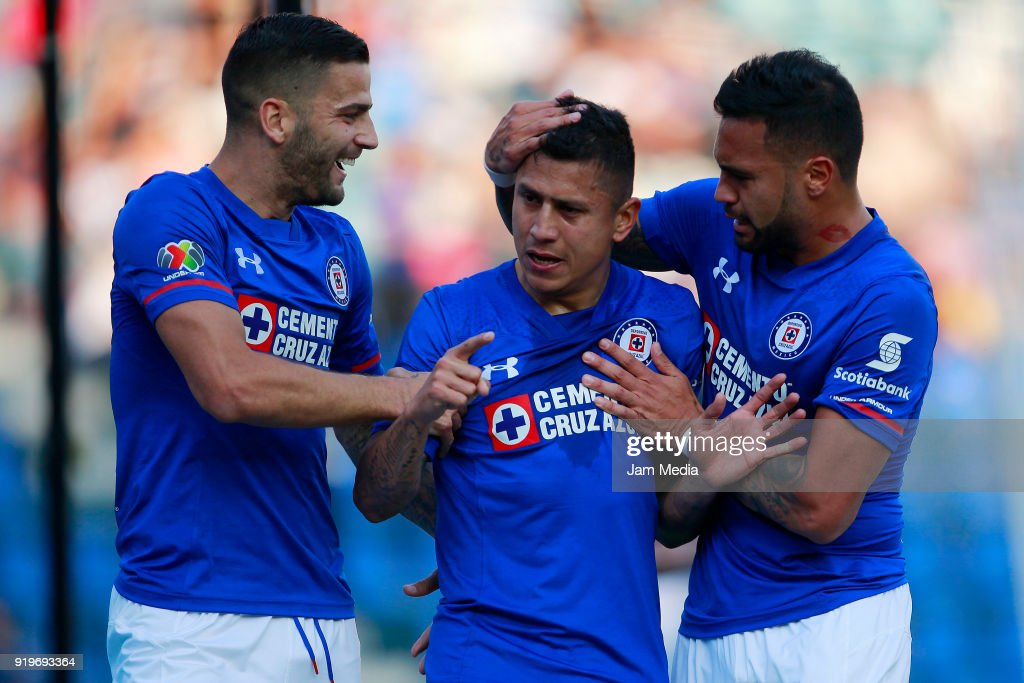 Julio Dominguez of Cruz Azul celebrates with teammates Martín Cauteruccio and Julian Velazquez after scoring the first goal of his team with teammates during the 8th round match between Cruz Azul and Puebla as part of the Torneo Clausura 2018 Liga MX at Azul Stadium on February 17, 2018 in Mexico City, Mexico.