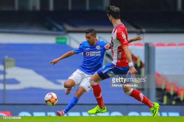 Julio Dominguez of Cruz Azul struggles for the ball against Rodrigo Noya of Atletico San Luis during the 16th round match between Cruz Azul and...