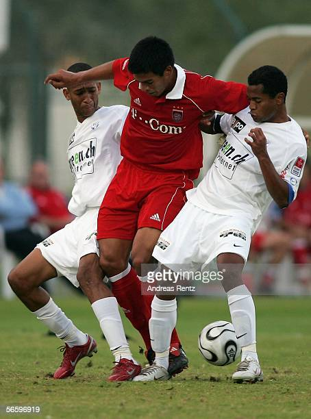 Julio Dos Santos of Munich in his first match for Bayern Munich challenges for the ball with Clederson de Souza Cesar and Rafael de Auraujo Rafael...