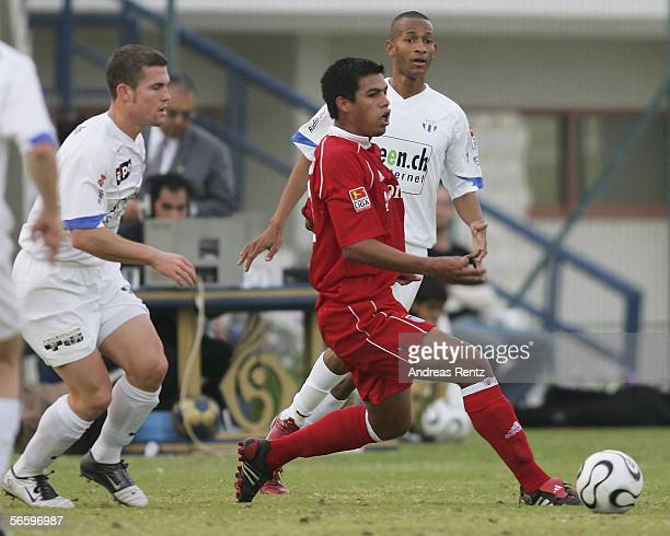 Julio Dos Santos of Munich in his first match for Bayern Munich competes with Daniel Stucki and Clederson de Souza Cesar during the friendly match...