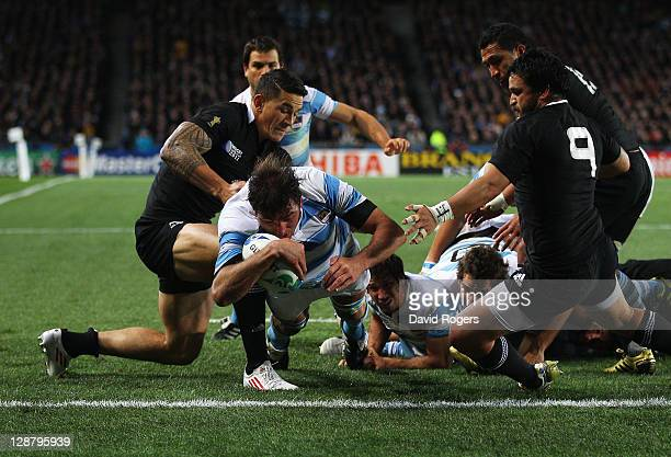 Julio Farias Cabello of Argentina goes over to score the opening try during quarter final four of the 2011 IRB Rugby World Cup between New Zealand...
