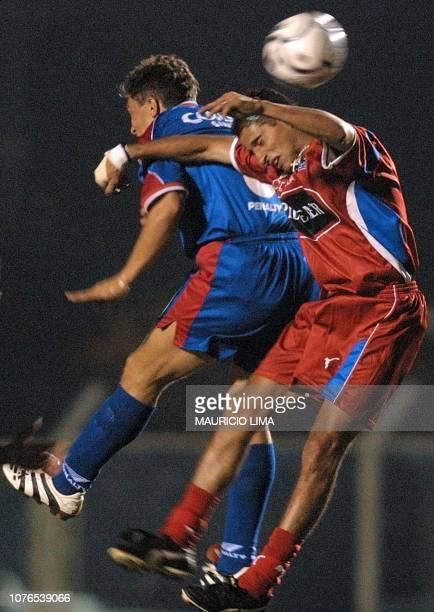 Julio Fleitas player of the Olmedo team of Ecuador fights for the ball with Sinval of Sao Caetano of Brazil in the Anacleto Campanella Stadium April...