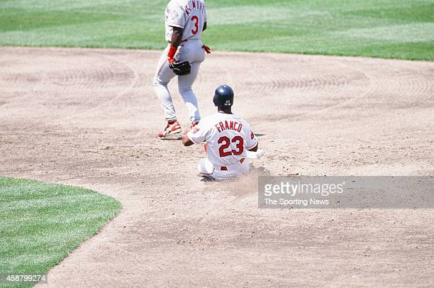 Julio Franco of the Cleveland Indians slides against the Texas Rangers at Progressive Field on May 19 1996 in Cleveland Ohio