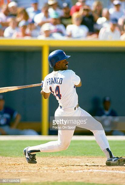 Julio Franco of the Texas Rangers bats against the Toronto Blue Jays during a Major League Baseball spring training game circa 1991 at Charlotte...