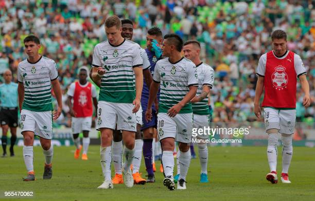 Julio Furch and Osvaldo Martinez of Santos leave the field after the quarter finals second leg match between Santos Laguna and Tigres UANL as part of...
