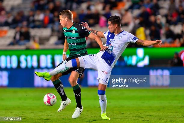 Julio Furch of Santos and Alexis Pena of Pachuca compete for the ball during the 13th round match between Pachuca and Santos Laguna as part of the...