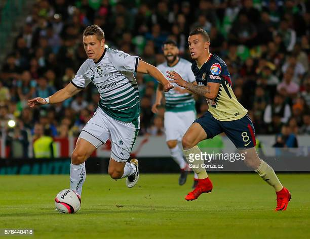 Julio Furch of Santos and Andres Uribe of America fight for the ball during the 17th round match between Santos Laguna and America as part of the...