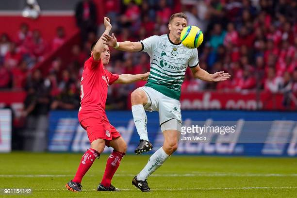 Julio Furch of Santos and Antonio Ríos of Toluca fight for the ball during the Final second leg match between Toluca and Santos Laguna as part of the...