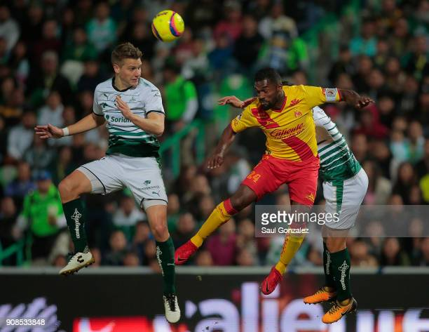 Julio Furch of Santos and Gabriel Achilier of Morelia goes for a header during the 3rd round match between Santos Laguna and Morelia as part of the...