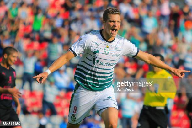 Julio Furch of Santos celebrates after scoring the first goal of his team during the 14th round match between Queretaro and Santos Laguna as part of...