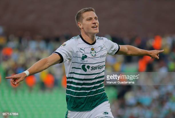 Julio Furch of Santos celebrates after scoring the second goal of his team during the semifinals first leg match between Santos Laguna and America as...